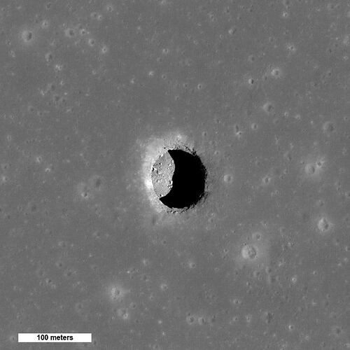 Spectacular high Sun view of the Mare Tranquillitatis pit crater revealing boulders on an otherwise smooth floor. The 100 meter pit may provide access to a lunar lava tube. Image Credit: By NASA/GSFC/Arizona State University - http://photojournal.jpl.nasa.gov/catalog/PIA13518, Public Domain, https://commons.wikimedia.org/w/index.php?curid=54853313