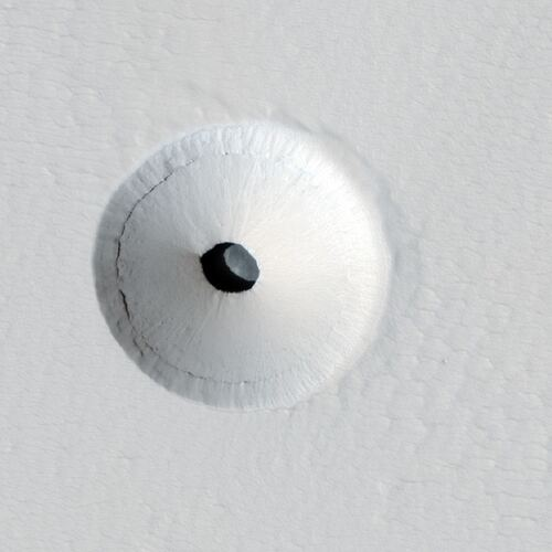 This is a cropped version of a HiRISE image of a lava tube skylight on the martian volcano Pavonis Mons. Image Credit: By NASA / Jet Propulsion Laboratory / University of Arizona - http://hirise.lpl.arizona.edu/ESP_023531_1840, Public Domain, https://commons.wikimedia.org/w/index.php?curid=20314169