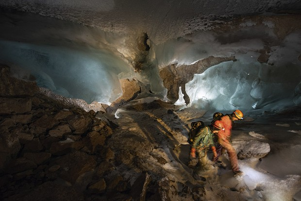Two members of the team inside the cave, surrounded by blue ice © Robbie Shone