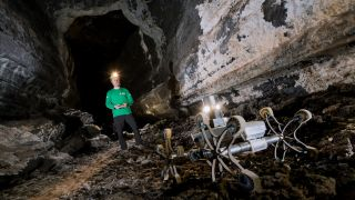 A prototype rover creeps through a lava tube in Spain's Canary Island of Lanzarote, part of a training campaign to explore settings on Earth that could be similar to those on the moon and Mars.