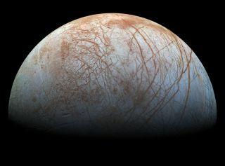 Jupiter's moon Europa, imaged here by NASA's Galileo spacecraft, harbors a huge ocean beneath its icy shell.