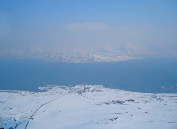 View from the Zeppelin station at Ny-Ålesund on Svalbard in spring 2006. Particles originating from agricultural fires in Eastern Europe combined with an extreme weather situation that transported the pollution to the Arctic were responsible for this pollution event. Arctic Monitoring and Assessment Programme, 2006