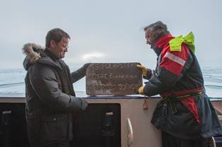 Chief scientist and the captain hold a steel plaque that was especially made for our visit to the North Pole.